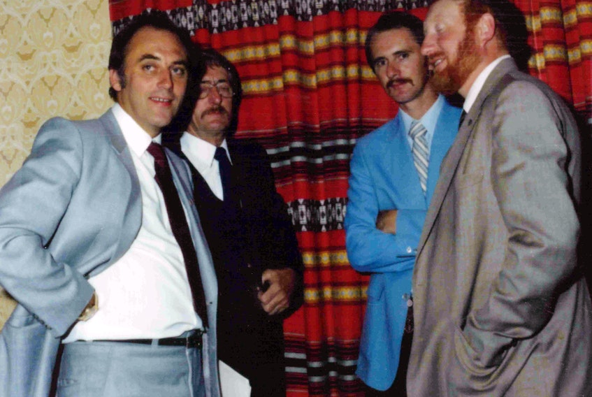 While ultimately rewarding, volunteering can be very stressful work, Horatio Cluett says. He began his efforts to see a golf course created on the Burin Peninsula in the late 1970s, a goal it took 16 years to realize. Here, he's pictured during his first golf course presentation in 1979. (From left) Brian Peckford, Melvin Grandy, Horatio Cluett and Bill Matthews. CONTRIBUTED
