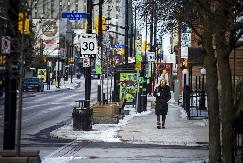 A woman walks down Elgin Street on Sunday Dec. 27, 2020.