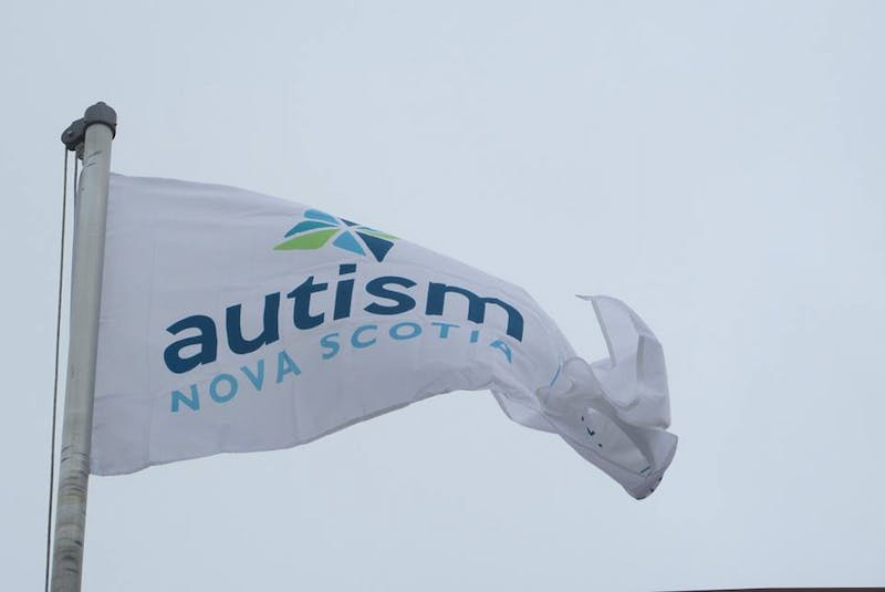 The Autism Nova Scotia flag flying outside the County of Kings municipal complex. - Contributed