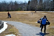 A pair of golfers wrap up a game at the West Pubnico golf course for the first round of the season. KATHY JOHNSON
