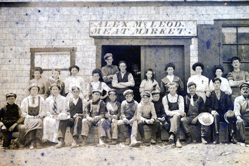 Workers in front of Alex MacLeod's meat market. He sold meat here and also delivered the product door-to-door. CONTRIBUTED