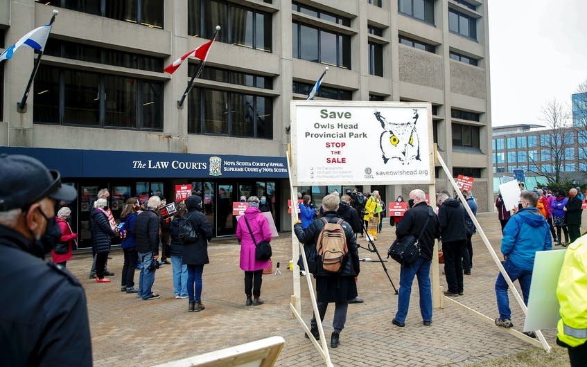 Supporters of Save Owls Head provincial park take part in a rally outside the law courts building in Halifax on April 1. - Tim Krochak