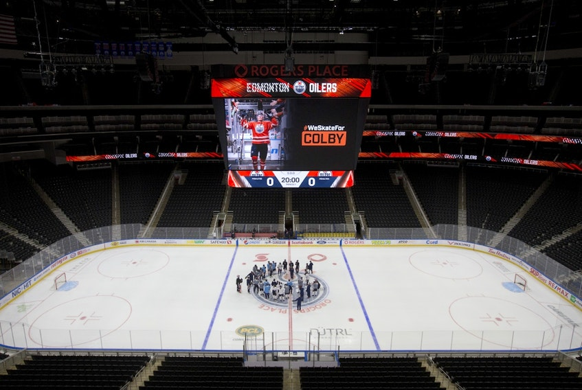 An image of Colby Cave is visible on the scoreboard during the Edmonton Oilers' first day of training camp for the 2019-20 NHL Return to Play season, at Rogers Place in Edmonton on July 13, 2020.