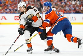 Connor McDavid (97) of the Edmonton Oilers battles against Rickard Rakell (67) of the Anaheim Ducks in Game 3 of the Western Conference second round during the 2017 NHL Stanley Cup Playoffs at Rogers Place on April 30, 2017, in Edmonton.