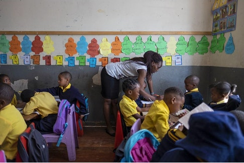 Kwanele Nkala teaches her five-year-old students at a primary school in Yeoville, a district of Johannesburg. Kwanele left Zimbabwe, where she studied to be a teacher, and was recruited to work at this school intended primarily for migrant children, who often are unwelcome at public schools. Photo by Miora Rajaonary. Photos and caption courtesy of National Geographic.