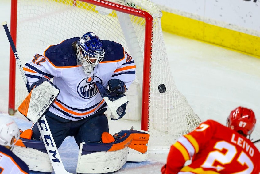 Edmonton Oilers goalie Mike Smith makes a save on Josh Leivo of the Calgary Flames in this photo from March 15.
