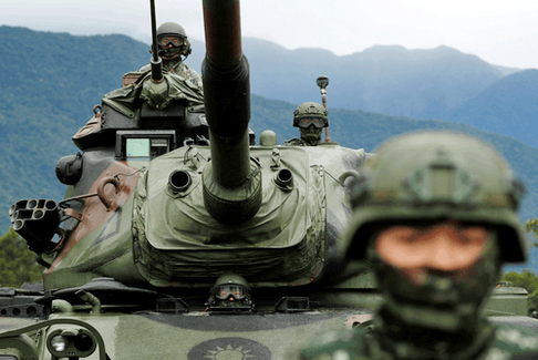 A Taiwanese soldier stands in front of a M60A3 tank during a military drill in Hualien, Taiwan, January 30, 2018.