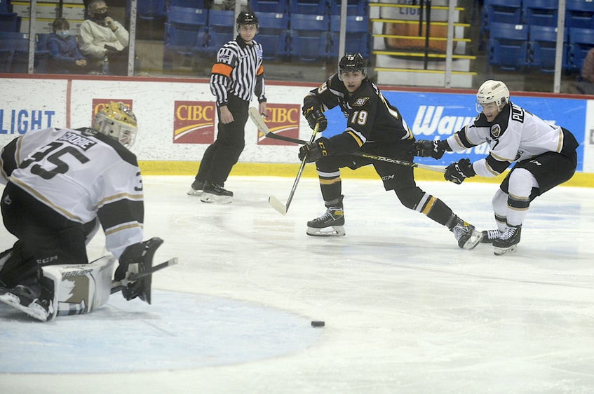 Cape Breton Eagles left-winger Lucas Canning, centre, tries to connect with linemate Davis Cooper during a first period rush against the Charlottetown Islanders Sunday at the Eastlink Centre. - Jason Malloy