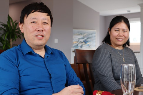 Richard Xu, left, and Sarah Huang are enrolled in a program offering free French lessons for newcomers.