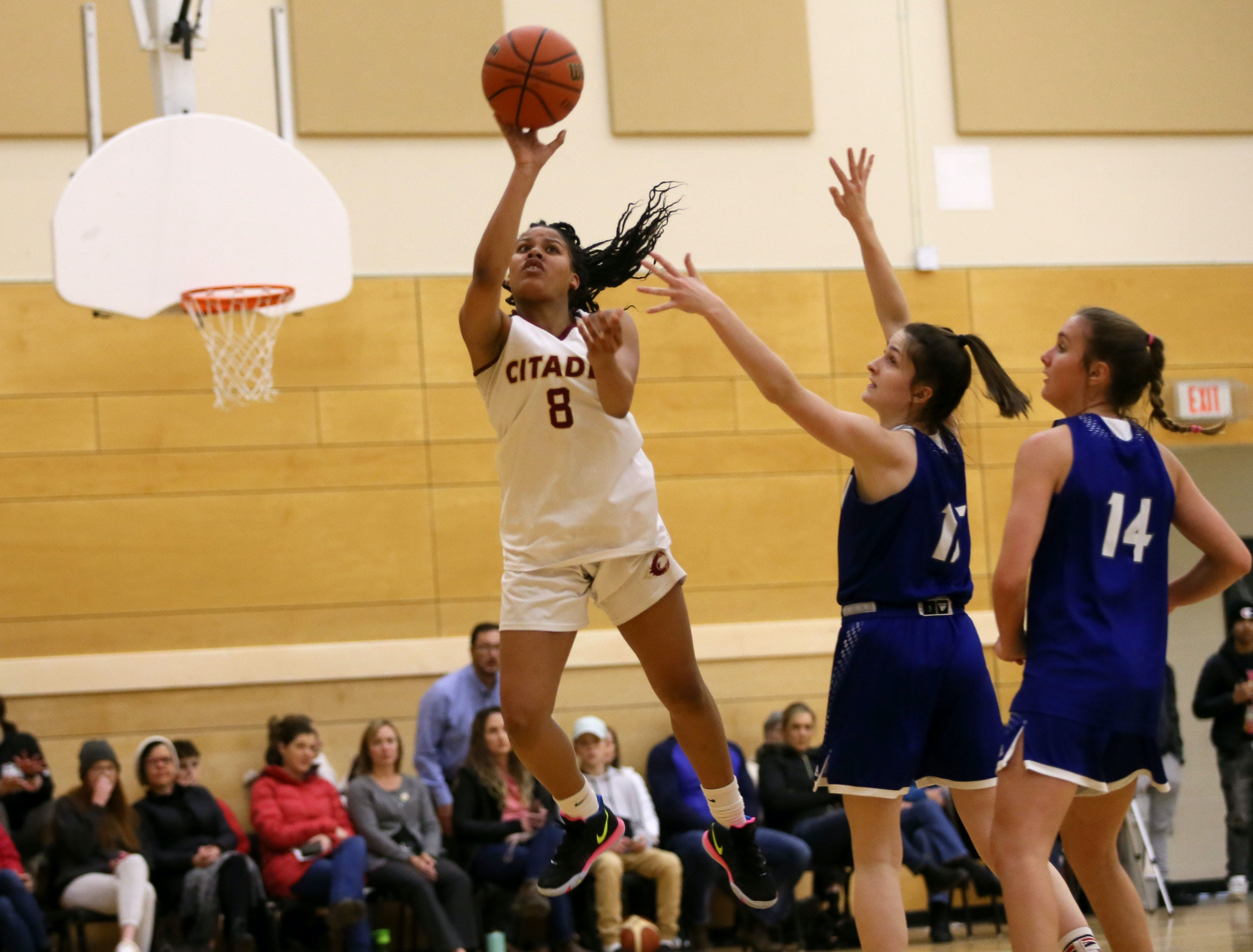 Citadel's Kyasiah Derry drives to the hoop past Lockview defenders Emma Foye and Ellie Lancaster during a metro high school basketball league game. The Phoenix will face the Dartmouth Spartans in the Capital Region championship on Tuesday. - Tim Krochak / The Chronicle Herald