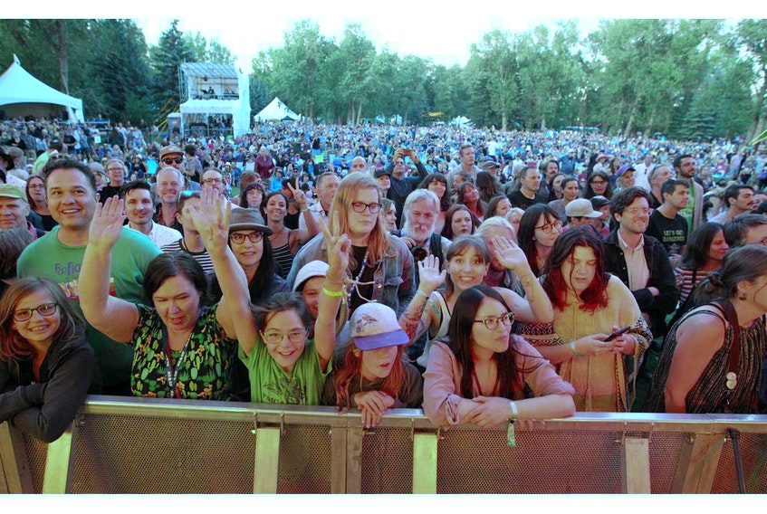 Fans react as Belle & Sebastian perform on the ATB Main Stage during the 40th Annual Calgary Folk Music Festival at Prince's Island Park Thursday, July 25, 2019.