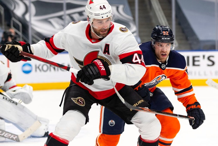 Ottawa Senators' Erik Gudbranson battles with Edmonton Oilers' Patrick Russell during first period NHL action at Rogers Place in Edmonton, on Wednesday, March 10, 2021.