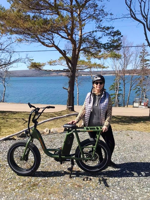 Graca Hollet made a wise wardrobe choice before heading out for a bike ride at Kempt Head, on Boularderie Island, Cape Breton.  While it was a pleasant day, Graca wisely dressed in layers. - contributed
