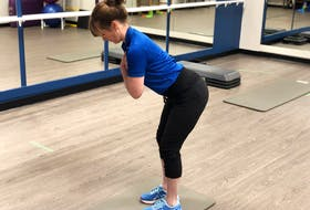 Laura Lundquist demonstrates the hip-hinge movement to avoid lower back pain. - Photo Contributed.