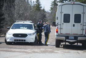 Police vehicles pass through an RCMP checkpoint on Portapique Beach Road on Wednesday, April 22, 2020. Ryan Taplin - The Chronicle Herald