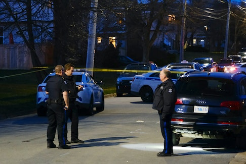 Halifax regional police are seen on Lahey Road at Clarence Street as they investigate reports of a shooting in Dartmouth Thursday evening April 8, 2021. TIM KROCHAK PHOTO