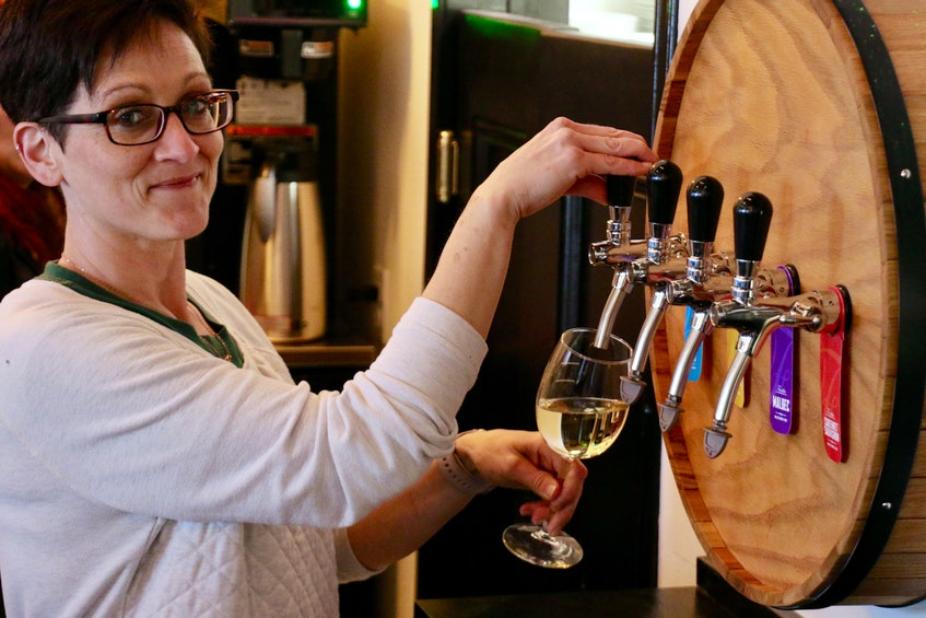 Jeannette Galley, the manager at the Hole in the Wall, pours a glass of white wine. The new restaurant will serve wine on tap and by the bottle. - Carole Morris-Underhill
