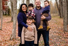 Carolynn Dubé, executive director of Fertility Matters Canada, with her three sons and husband Bryan. Originally a Coté from North Sydney, Dubé became involved in fertility advocacy, education and awareness after becoming a mom to three boys through in vitro fertilization treatment. The couple's sons, pictured here, are seven-year-old Bren and two-year-old twins Shae, in his mother's arms, and Theo, in his dad's. CONTRIBUTED