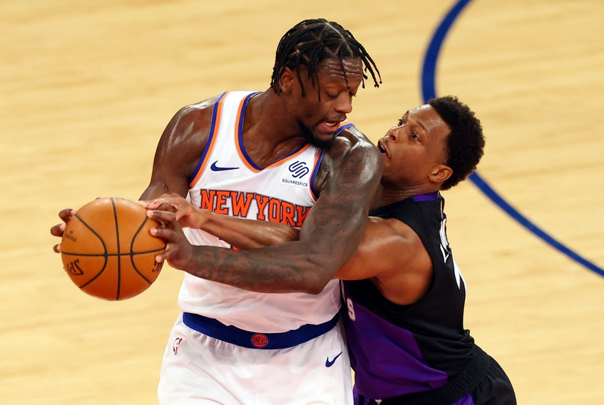 Julius Randle of the Knicks (left) is guarded by Raptors' Kyle Lowry during their game at Madison Square Garden on April 11, 2021 in New York City.