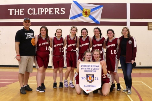 The Islands Consolidated School team with their regionals championship banner. Pictured are (Back row) Coach Mike Thimot, Rhynda Tudor, Myia Brown, Bella Titus, Madison Lent, Jayden Lewis, Katie Moore, Coach Jessica Thimot, (Front row) Lauren Sollows and Gracie Frost. AMY TUDOR PHOTO