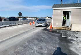 A motorist pulls up to the Nova Scotia entry control point at Fort Lawrence in this photo from March. Hopes of a reconnection to the Atlantic bubble on April 19 appear to be dashed as Nova Scotia Premier Iain Rankin announced Tuesday that New Brunswickers will have to self-isolate for 14 days upon entering the province due to a spike in COVID-19 cases in that province.