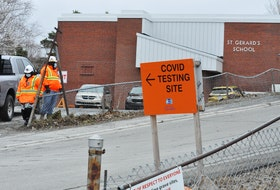 A vehicle drives into the parking lot of St. Gerard's School in Corner Brook on Monday afternoon. Due to recent cases being identified in the western region, Western Health is conducting COVID-19 testing at the site until Wednesday for anyone who wants to be tested whether or not they are symptomatic. Another clinic is being held at the town hall in Meadows. Both clinics were fully booked as of Monday morning.