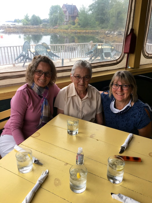 Lydia Crossley, flanked by her daughters Marilyn Redden, left, and Karen Crowe, said she enjoyed spending more than six decades helping people get married. - Contributed