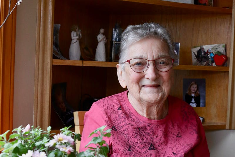 Lydia Crossley, sitting in front of a bookshelf featuring cherished family photos, says she's had some interesting experiences while serving as a deputy issuer of marriage licences for the provincial government — a job she held for more than six decades. - Carole Morris-Underhill