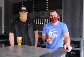 Friends Steve Martin, left, and Craig Farwell were co-organizers of the Newfoundland Craft Beer Festival before they decided to open a new bar and eatery highlighting the province's many breweries. — Andrew Robinson/The Telegram