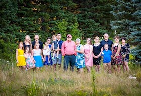 In a twist of fate, says Emilie Chiasson, far right, her three older brothers now have children of their own, and seven of the eight are girls.