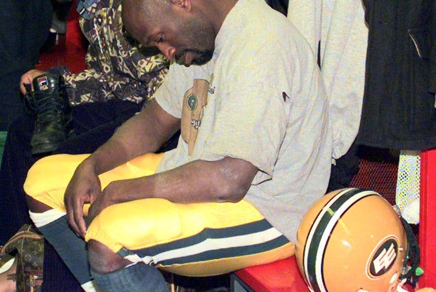 Edmonton defensive back Don Wilson (25) sits dejected in the dressing room following a loss in the West Division final to the Calgary Stampeders on Nov. 14, 1998.Ed Kaiser / Postmedia, file
