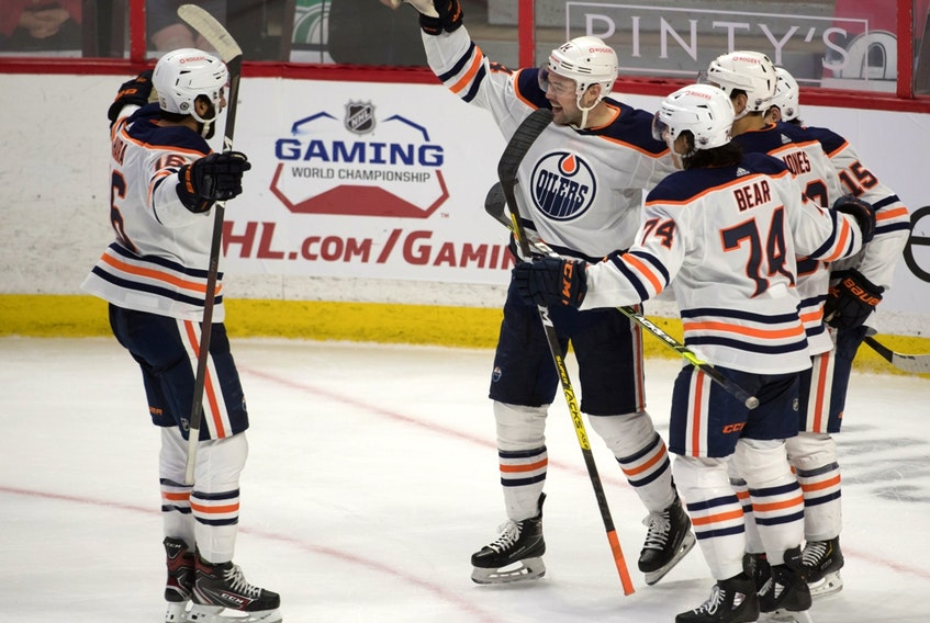 Edmonton Oilers centre Devin Shore (14) celebrates with teammates after scoring a goal against the Ottawa Senators at the Canadian Tire Centre on April 8, 2021.