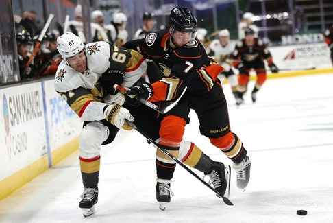 Anaheim Ducks defenceman Ben Hutton (right) battles Max Pacioretty of the Vegas Golden Knights during a game in Februar. The Maple Leafs acquired Hutton on Monday for a fifth-round pick in 2022.