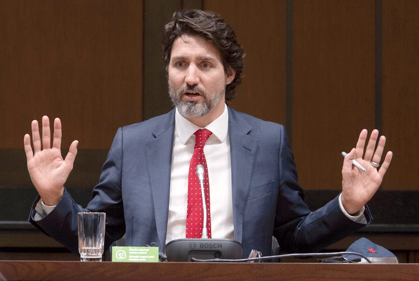 Prime Minister Justin Trudeau responds to a question during a year end interview with The Canadian Press in Ottawa, Wednesday December 16, 2020.