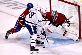 Montreal Canadiens goaltender Jake Allen makes a save on Maple Leafs centre Jason Spezza last night.USA TODAY Sports