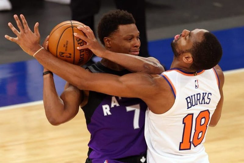 Kyle Lowry (left) protects the ball against Alec Burks of the New York Knicks during an NBA game.- USA TODAY Sports
