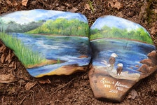 Some of the stones were painted by artists, including these two in memory of Sean McLeod and Alanna Jenkins of West Wentworth, N.S.