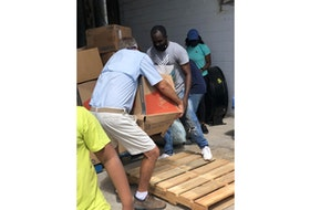 A box is unloaded from a 48-foot container that arrived recently in Grand Bahamas from Prince Edward Island. Luke Ignace, a student in P.E.I. and a businessman, who is a native of Grand Bahamas, held a fundraising drive last year to put together a relief package for the country that was devastated two years ago by hurricane Dorian. Items sent to Grand Bahamas include water, towels, health and wellness supplies, menstrual products, diapers, masks and water filtration units. Ignace travelled to Grand Bahamas to help his brother, Osni, organize the donated items. The Rotary Club of the Bahamas provided a warehouse to store the items while the Rotaract Club of Eight Mile Rock was on hand to help with off-loading the items. To see boxes from P.E.I. arrive in Grand Bahamas, click on this story at www.theguardian.pe.ca.