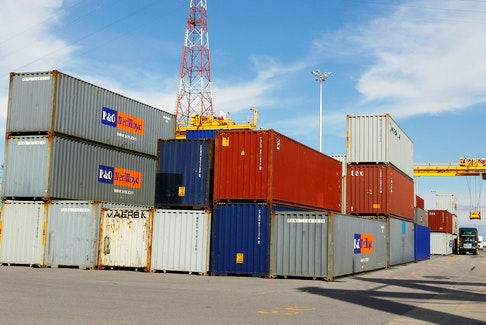 A truck is loaded with a container at the Port of Montreal. REUTERS/Shaun Best/File Photo