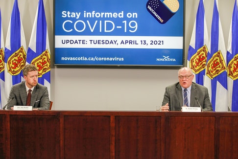 Premier Iain Rankin and Dr. Robert Strang, Nova Scotia's chief medical officer of health, hold a COVID-19 briefing in Halifax on Tuesday, April 13, 2021. - Communications Nova Scotia