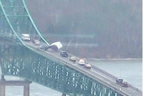 A truck and trailer flipped on the Seal Island bridge on Highway 105 in Boularderie        East, at about 9:36 a.m. Tuesday morning. The bridge is currently closed and efforts are underway to remove the vehicles. Facebook photo