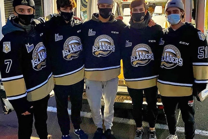 Volunteers from the Charlottetown Islanders help at a food drive for the Upper Room Hospitality Ministry. - Submitted by Upper Room Hospitality Ministry. - Saltwire network