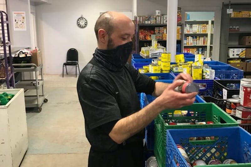 A volunteer sorts food items at the food bank for Upper Room Hospitality Ministry. - Submitted by upper room Hospitality ministry. - Saltwire network