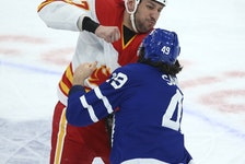 Calgary Flames' Milan Lucic fights Toronto Maple Leafs' Scott Sabourin during Tuesday's game.