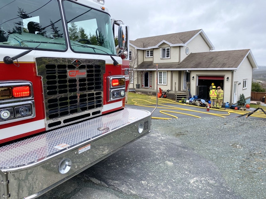 On arrival, firefighters found smoke coming from a garage but were able to extinguish the small blaze. - Keith Gosse/The Telegram