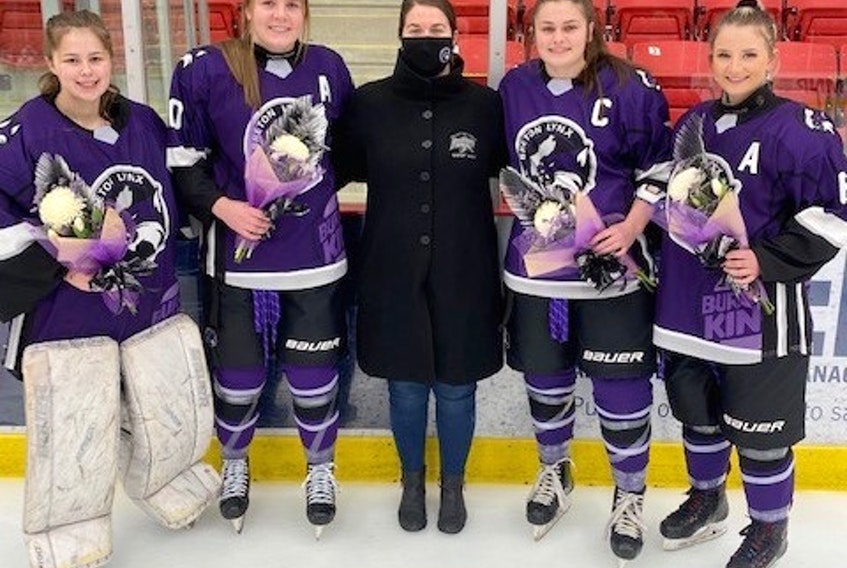 Four members of the Cape Breton Lynx of the Maritime Female Under-18 Major Hockey League recently finished their final season with the Membertou-based team. From left, Emma Swansburg (Shelburne), Jessica MacLean (Iona), Sonya Lynk (head coach and owner), Madison Corbett (Whitney Pier) and Morgan Bates (New Waterford). CONTRIBUTED • PAUL CARROLL