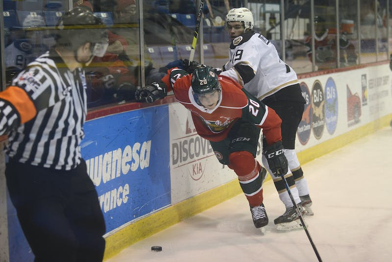 Halifax Mooseheads captain Justin Barron, centre, spins off the check of Charlottetown Islanders winger Patrick LeBlanc Tuesday during Quebec Major Junior Hockey League contest at the Eastlink Centre. - Jason Malloy • The Guardian