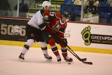 Halifax Mooseheads defenceman Jason Horvath, right, tries to spin away from the forecheck of Braeden Virtue of the Charlottetown Islanders Tuesday in Charlottetown.