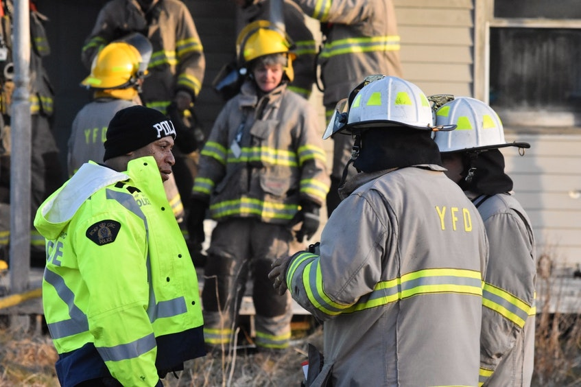 An RCMP member speaks with firefighters at the scene of a small fire at a vacant property in Melbourne, Yarmouth County the morning of April 14. TINA COMEAU • TRICOUNTY VANGUARD