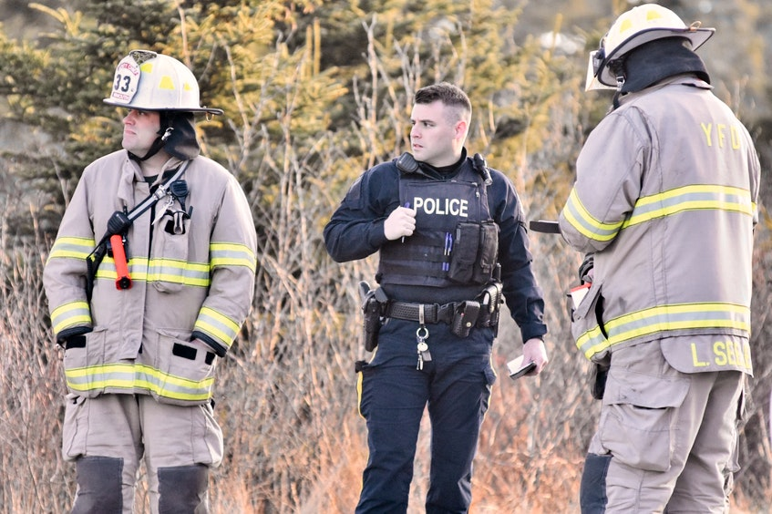 An April 14 fire at a vacant property in Melbourne, Yarmouth County, is under investigation. An RCMP member speaks with firefighters at the scene. TINA COMEAU • TRICOUNTY VANGUARD